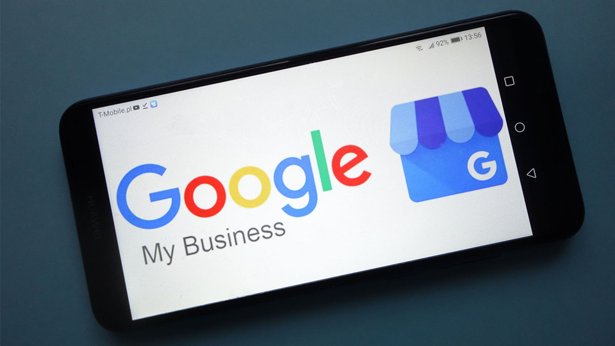A smartphone displays the Google My Business logo